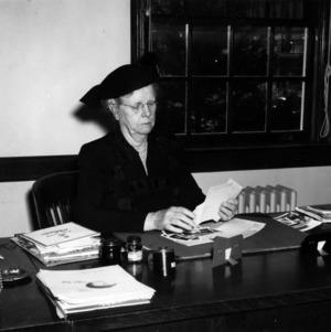 Mrs. Rosalind Redfern at desk
