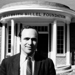 Jewish chaplain H. A. Rabinowitz in front of Enai Brith Hillel Foundation building