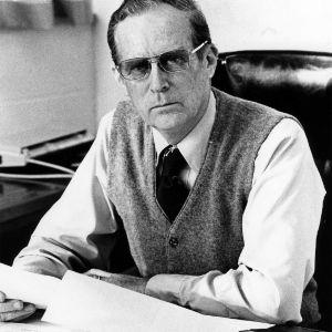 Dr. William M. Roberts at desk
