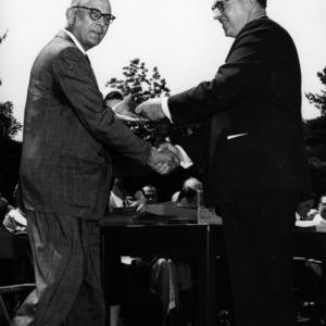 Robert Shoffner shaking hands with another man at event