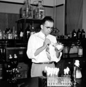 William Neal Reynolds Professor Dr. Marvin L. Speck in lab