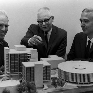 Dr. John Tyler Caldwell, Dr. Ralph Clay Swann, and Dr. Arthur Clayton Menius with models of campus buildings
