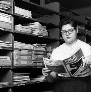 Woman reading Tobacco magazine in the archives