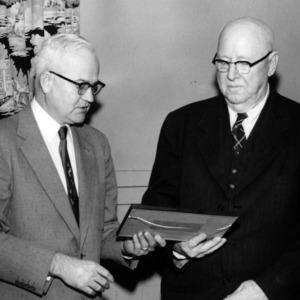 Dr. H. H. Bennett receiving a citation from Chancellor Bostian