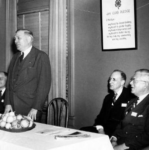 L. R. Harrill, State 4-H leader, Governor R. Gregg Cherry, and  Louis V. Sutton from Carolina Power and Light
