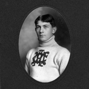 NC State College male student dressed in an athletic letter sweater.
