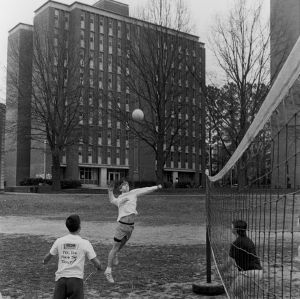 "Students playing volleyball at ""Tucker Beach"""