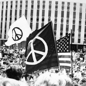Students in Brickyard protesting with peace signs