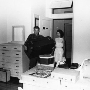 Student moving into her dorm room