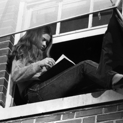 Student reading in her window