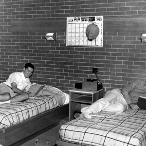 Students reading books in their dorm room