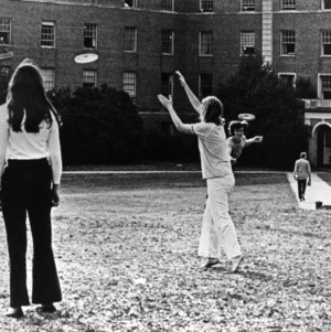 Students playing frisbee