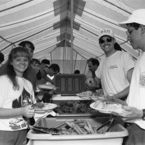 Young alumni at a barbecue