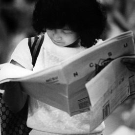Student reading newspaper