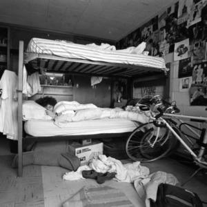 Student sleeping in dorm room