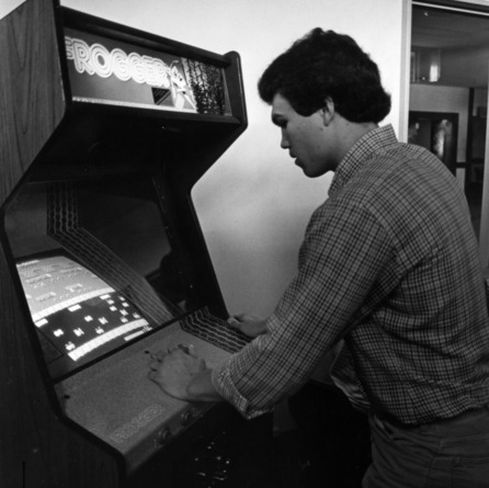 Student playing an arcade game