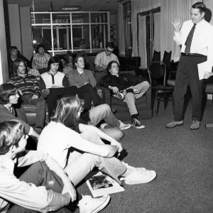 Clayton Stalnaker teaches his students in an informal residence hall setting