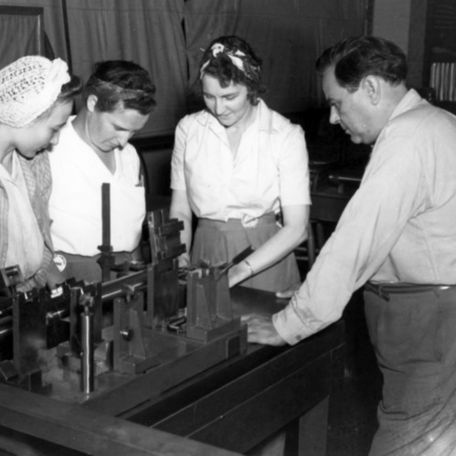Paul Keirn with girls employed in war production plant