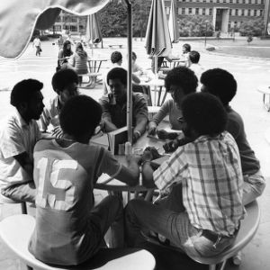 Students talking at a table outside D. H. Hill Jr. Library