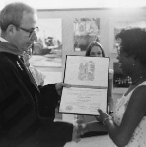 Civil Engineering student Deborah Bell receiving diploma from Ralph E. Fadum