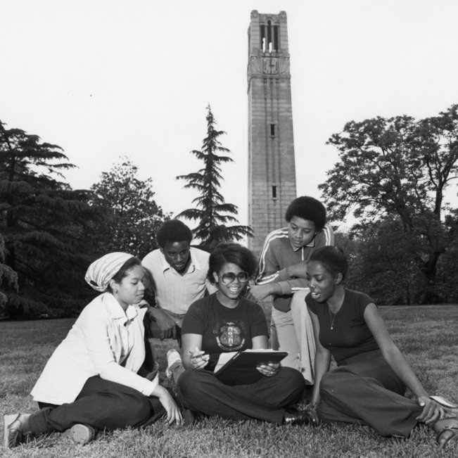 Students studying by the Bell Tower
