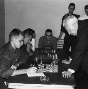 Students and Nowell Banks playing chess