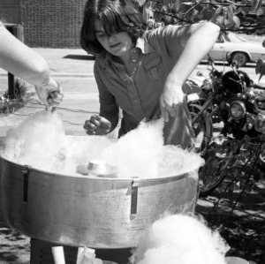 Making cotton candy at an outdoor event