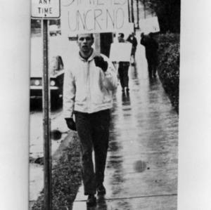 Man protesting University of North Carolina, Raleigh name change