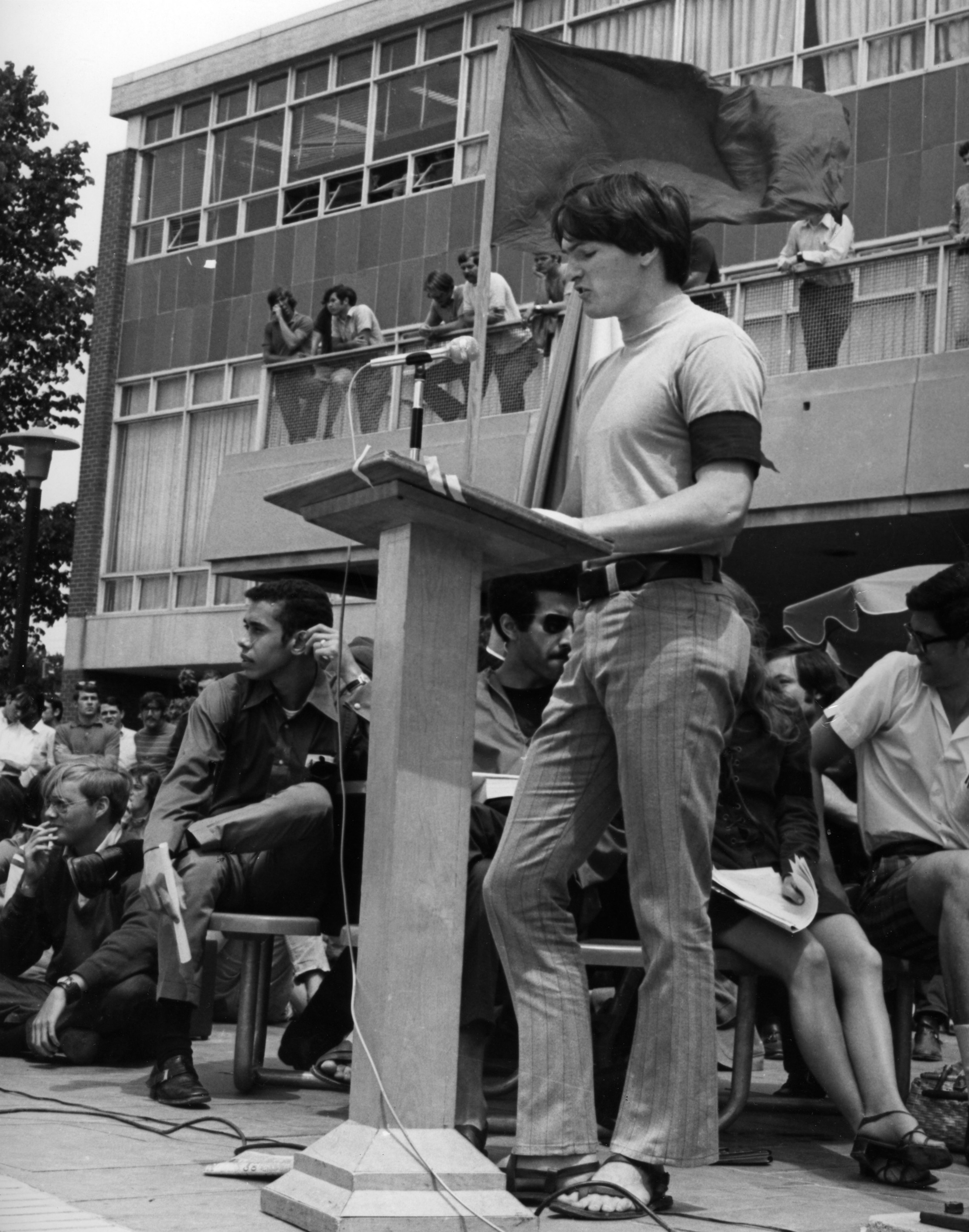Student giving speech by a podium