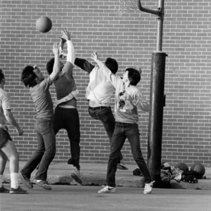 Students playing a pick-up game of Basketball