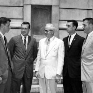 Senior Class Officers with Chancellor Bostian during commencement, 1958