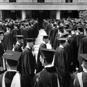 Students at graduation outside Reynolds Coliseum