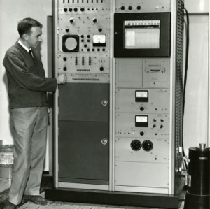 Student standing with a 256 Channel Analyzer