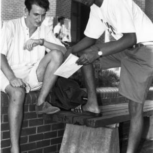 Students talking on the brickyard