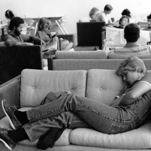 Student sleeping on a sofa