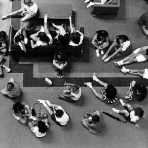 Group of students sitting on floor of the Student Center