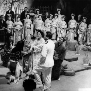 Actors perform scene of a play