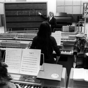 Music students taking piano class