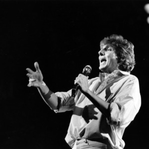Barry Manilow performing on stage