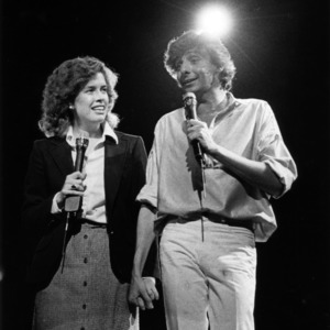 Barry Manilow on stage with a guest