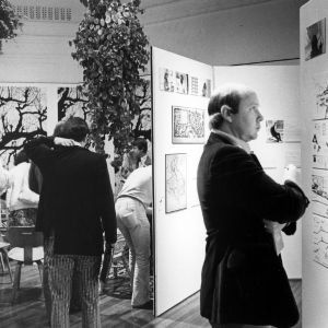 Students viewing paintings in an art exhibit