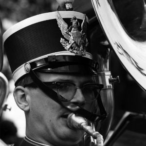 Head shot of unidentified marching band tuba player in glasses