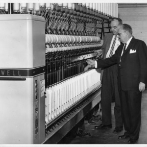 Elliot B. Grover and M. E. Campbell examining long draft worsted spinning frame