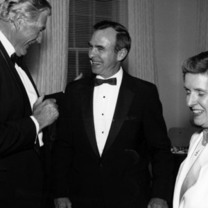 Former chancellors Bruce Poulton, Joab Thomas, and another woman at fundraising event