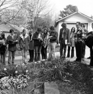 Horticulture class examining yard plants
