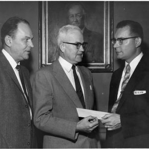 J. Bryant Kirkland and Carey H. Bostian with check