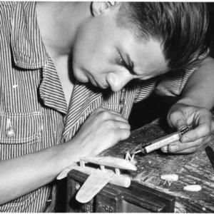 High school student H. B. Murray constructing model Vought Sikorsky plane