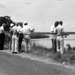 Group fishing along bank