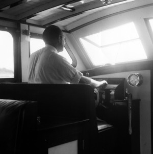 Morehead City Technical Institute's director Paul B. Mitchell at the helm of the State boat