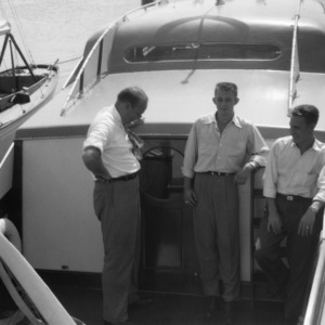 Morehead City Technical Institute's director Paul B. Mitchell and students aboard yacht